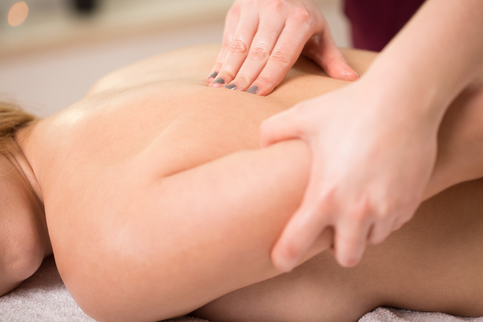 Close-up of young woman and back chiropractic